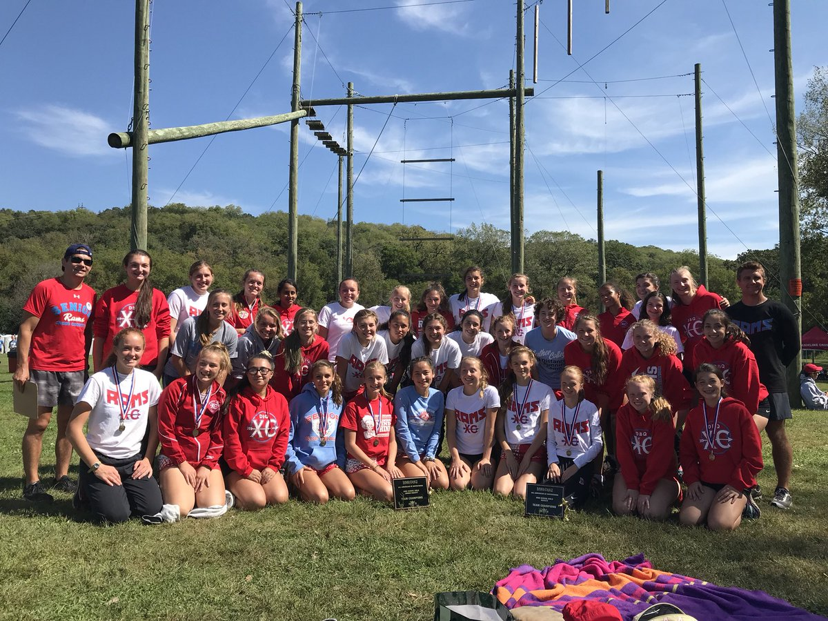 The team enjoy the beautiful weather during a meet at Luther College in Decorah, Iowa