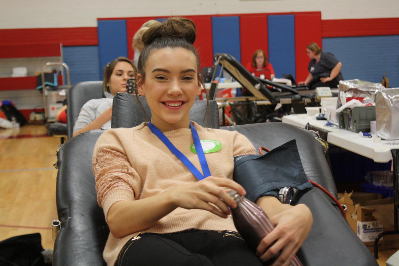 Kate Tonn (12) donates blood at the 2017 Blood Drive