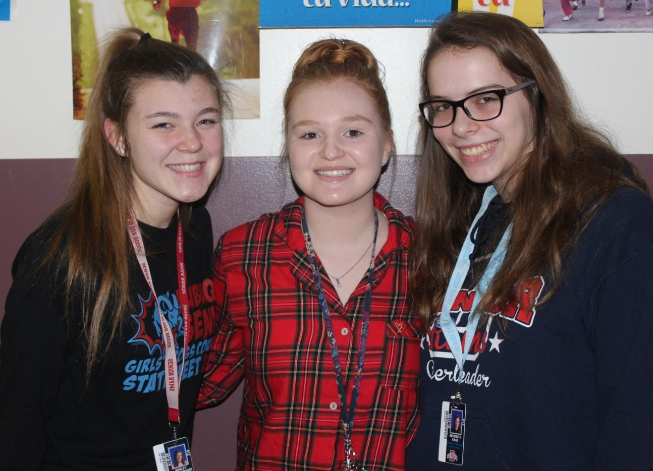 Bailey Hammerand (12), Maddi Lyons (12), and Meredith Kass (12) show off their PJs during Snowcoming week. The group could just as easily have been heading to a sleepover!