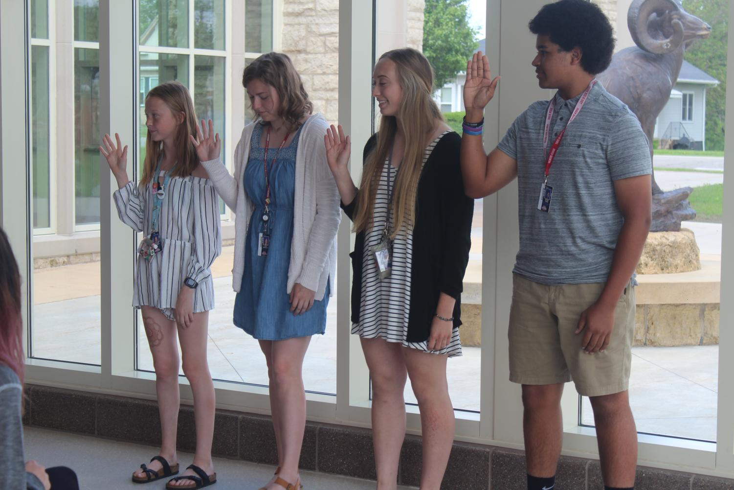 Lillian Schmidt, Ava Bradley, Rylee Capesius, and Gavin Guns are sworn in to their new Student Council roles