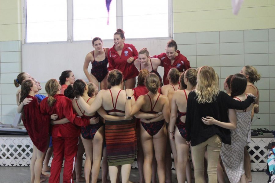 The+swim+team%2C+led+by+the+seniors%2C+cheer+before+their+meet+against+Wahlert