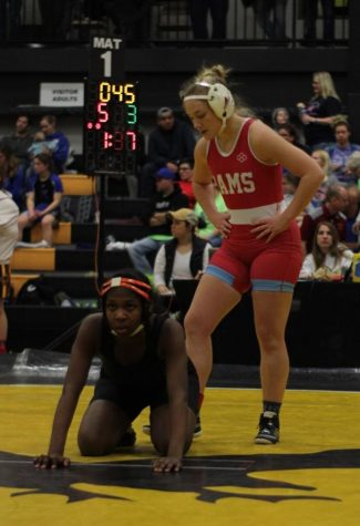Kes Whalen (12) takes her position before a match