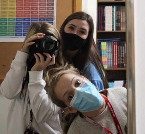Yearbook staff members Hannah Wolbers, Aubrey Goedken, and Aleeyah Steines joke around as they head out to take pictures around the building