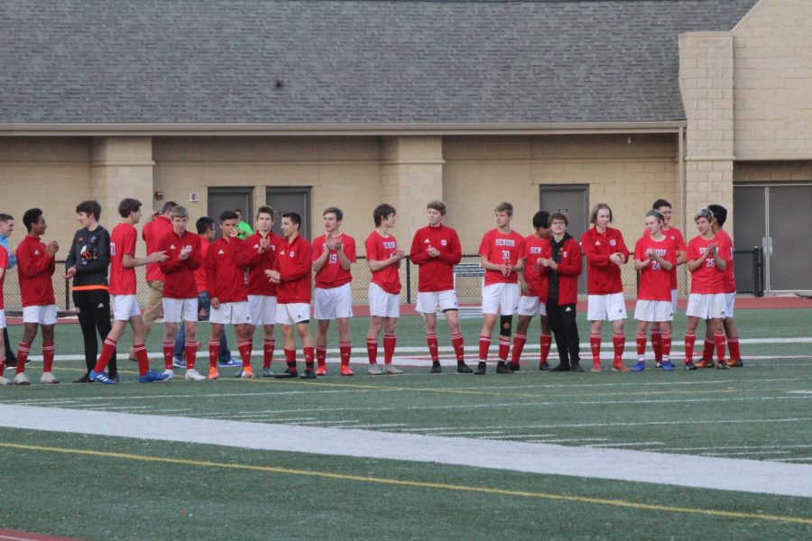 The team lines up before a spring 2019 game. The 2020 season was canceled due to Covid-19.