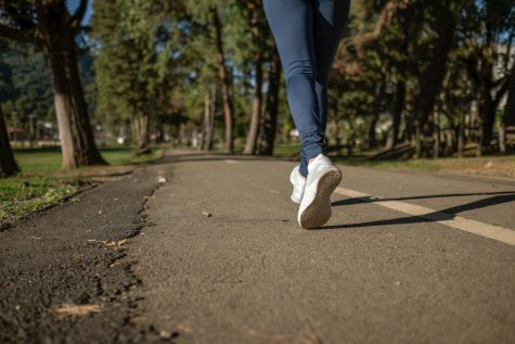"""Taking a walk is one way experts recommend to destress. If you are worried about getting """"stuck inside your own head,"""" listen to music while you walk."""